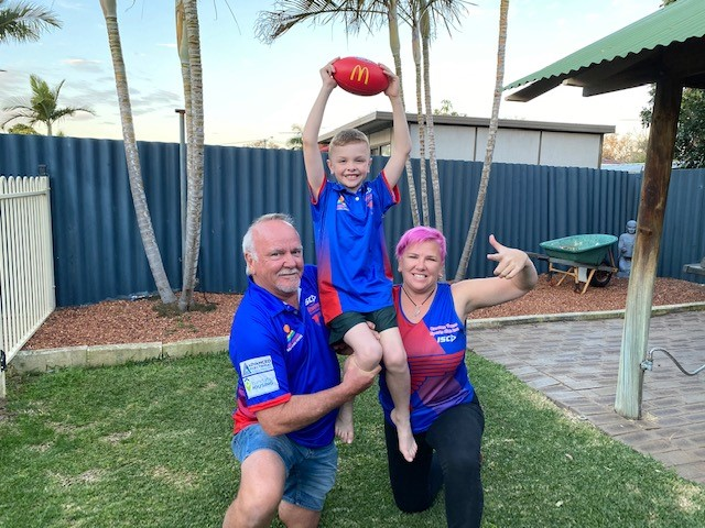 Tammy and her family in Broome FC shirts
