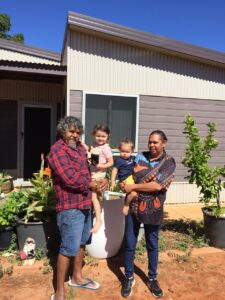 Michelle and her family outside their home